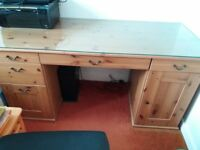 Wood desk with glass top, 5 drawers and a cupboard in perfect condition