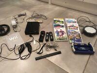Nintendo Wii black, 2 controllers, 2 nunchucks, 8 games
