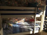 Bunk beds in white, good condition, with 2 clean mattresses
