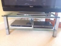 MODERN GLASS AND BRUSHED STEEL TV/DVD STAND IN VERY GOOD USED CONDITION FREE LOCAL DELIVERY