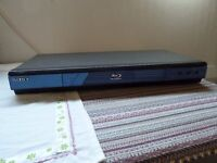 Sony Blu Ray Disc Player. Includes remote control and cables.