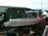 16 foot fishing boat with outboard pod and cudy