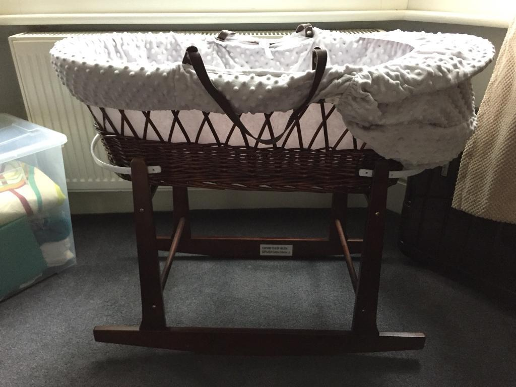 Moses basket on cradle stand