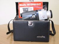 For sale a 8mm Minolta Autopak-8 K7 cine camera with a leather carrying case and owner's manual