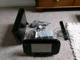 Wii U, 4 Wii Motes, Fit board & 10 games