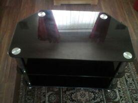 dark glass and chrome tv stand