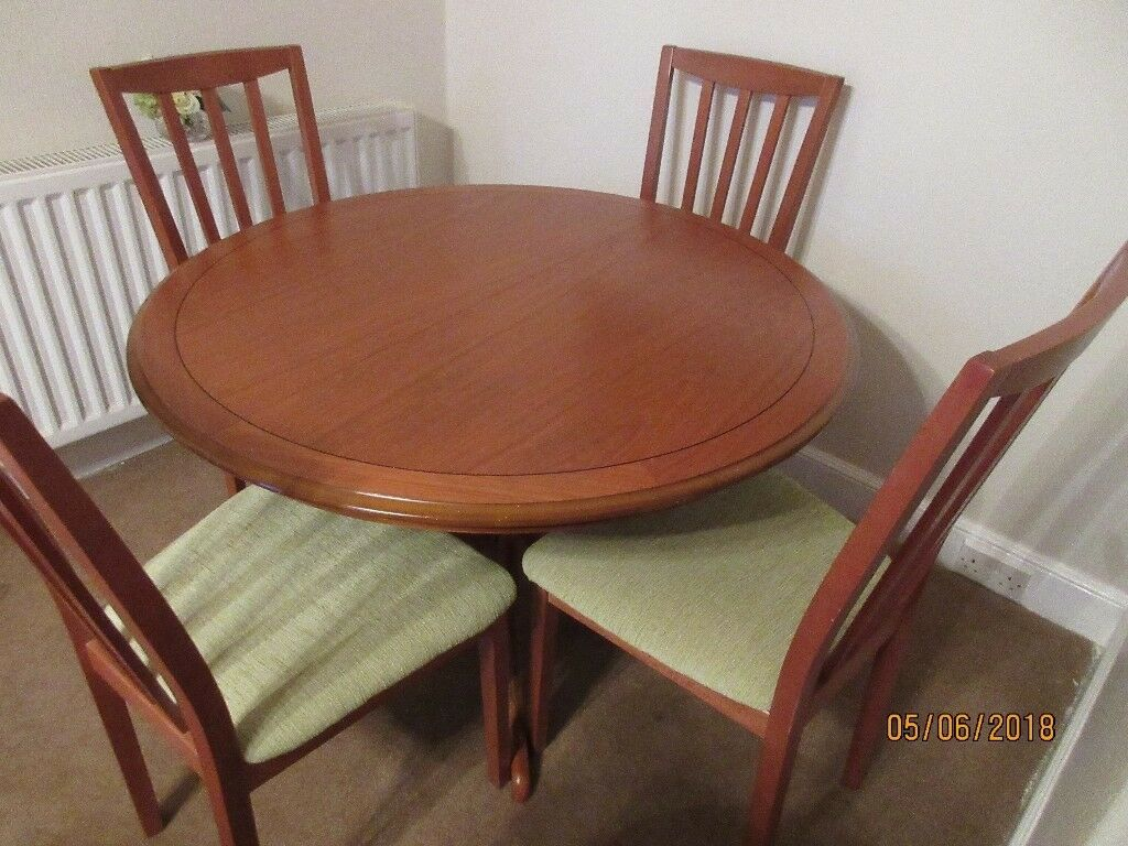 Morris teak dining set in excellent condition with newly recovered chairs in lime green material