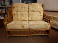 Good Quality & Robust Cane Furniture Settee and Armchair with metal sprung cushion support.