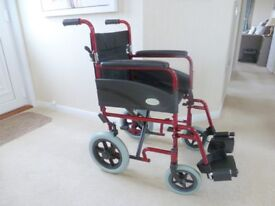 Wheelchair Suitable for an Elderly Person. Folds up flat and very light and robust. Easy to steer.