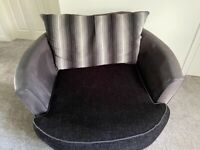 Lovely black spinning cuddle chair and footstool