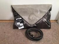 Brand new with tags clutch bag with detachable strap