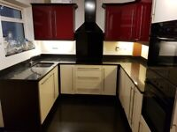 Gloss fitted kitchen units with quartz worktop