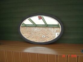 Retro Black Framed Oval Mirror. Bevel Edged with a Single Red Rose. Can Deliver.