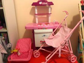 Bundle of toys kitchen pram and caring basket