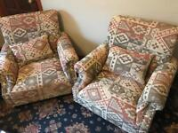 Pair of New Aztec fabric armchairs with tags