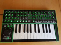 Roland Aira System One synthesiser with 'Decksaver' cover and Plug-Out