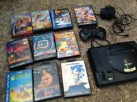 Sega megadrive with 10 games and 1 pad