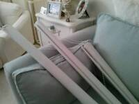 Three white blackout roller blinds