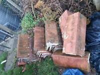 Old terracotta roof ridge tiles