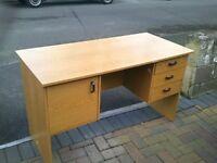 An assembled desk unit, in pine 'veneer'.