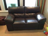 Two seater leather brown sofa