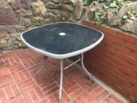 FREE!!! A well loved garden glass topped table for collection