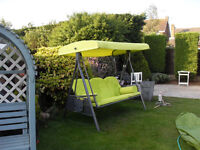 Three seater garden swing,with cushions.