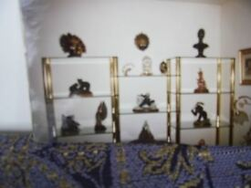 Glass living room ornament display unit with metal gold coloured tubes to erect.