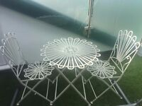 White metal garden table and two chairs
