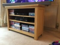 Solid oak corner tv stand. Used but in excellent condition.