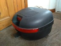 Motorcycle top box in used condition.