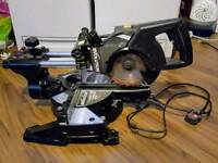 Evolution sliding mitre saw