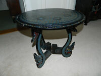 Small round laquered occasional table.