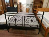 Black metal double bed frame with mattress