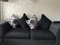 Black & Black/Grey flowers sofas in very good condition , DFS sofas