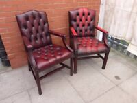 A Pair Of Oxblood Red Leather Chesterfield Gainsborough Chairs