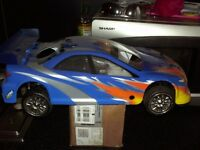 Nearly new cyclone 1-10th scale nitro powered touring car