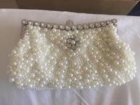 Pearl and diamanté clutch