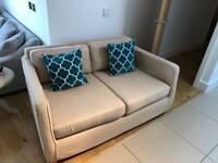 2 person cream sofa