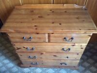 Solid pine chest with 5 draws.