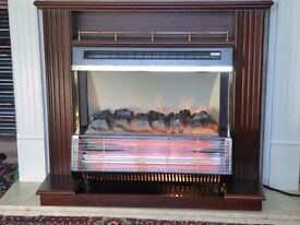 ELECTRIC FIRE 2 BARS WITH COAL EFFECT SET IN A DARK WOOD SURROUND