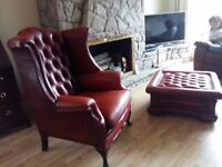 Absolutely stunning leather button back wing backed chair and footstool/storage box.