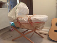 Mamas and Papas moses basket with stand, bedding, mobile and vibrating seat