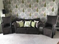 Two seater sofa bed (with mattress included) plus x2 high back chairs and all cushions as shown. VGC