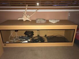 Vivarium forsale , heat pad with thermostat, lights water bowl etc , in great condition .