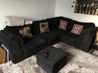 Black corner sofa. Material. Lovely condition.