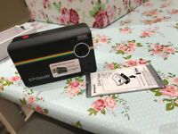Polaroid instant print z2300 camera with 100 Polaroid zink photo paper included