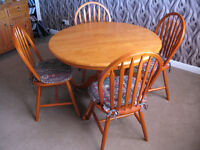 Round Dining Table and four Chairs