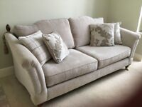 Large three seater sofa and two cuddle chairs