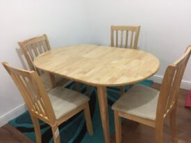 Dining table including 4 chairs